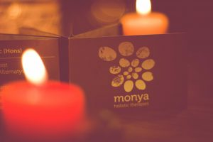 Monya aromatherapy candle and logo
